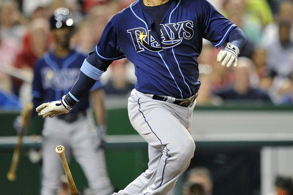 June 20, 2012; Washington, D.C., USA; Tampa Bay Rays first baseman Carlos Pena (23) singles in the eighth inning against the Washington Nationals at Nationals Park. The Nationals defeated the Rays 3 - 2. Mandatory Credit: Joy R. Absalon-US PRESSWIRE