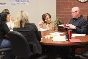 A teacher speaks with parents of the African American Parent Committee. (Photo courtesy of Daniel Campbell, Rangeview Raider Review)