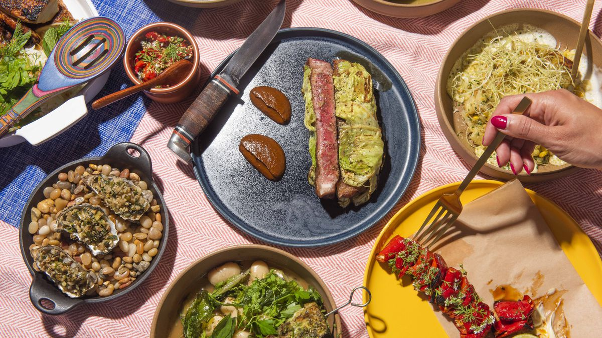 A table of colorful plates of food from Copas on Marker