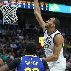 Utah Jazz center Rudy Gobert (27) dunks during the game against the Golden State Warriors at Vivint Arena in Salt Lake City on Tuesday, April 10, 2018.