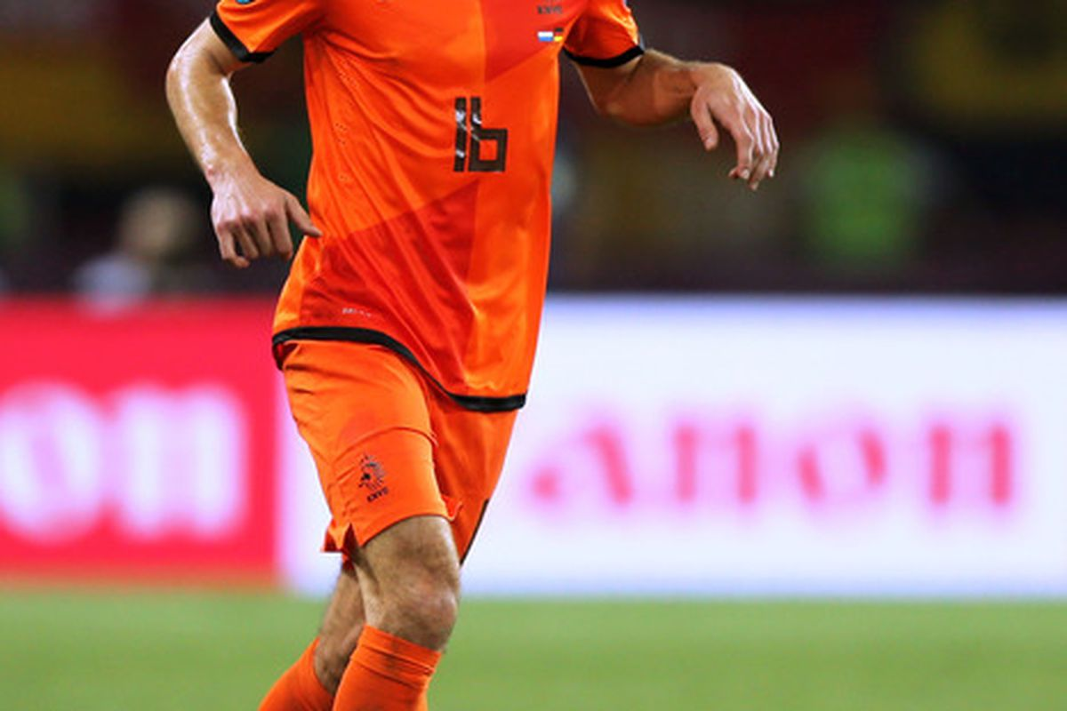 KHARKOV, UKRAINE - JUNE 13:  Robin van Persie of Netherlands controls the ball during the UEFA EURO 2012 group B match between Netherlands and Germany at Metalist Stadium on June 13, 2012 in Kharkov, Ukraine.  (Photo by Ian Walton/Getty Images)