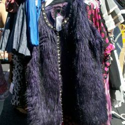 Purple furry vest for $7.49. Didn't seem like such a good buy in the 90 degree heat.