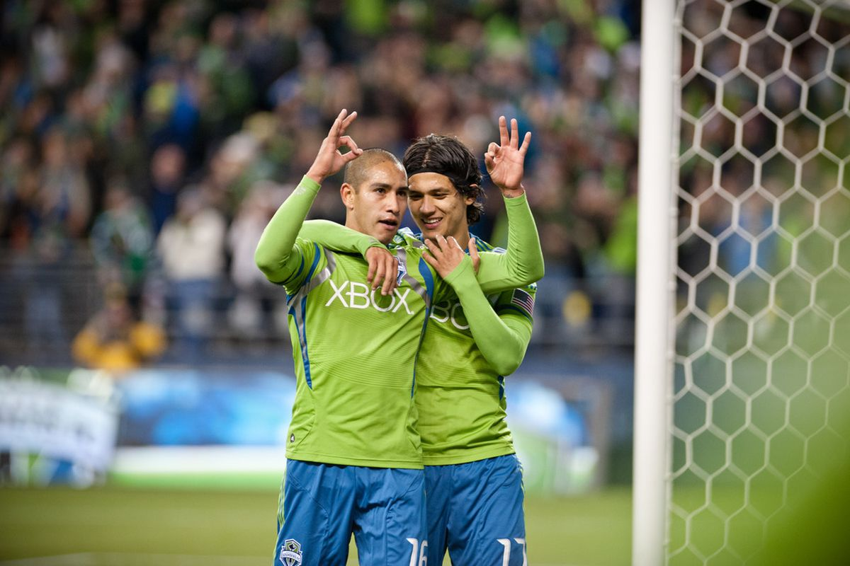 """David Estrada celebrates his third goal with Fredy Montero. (Photo by Jane Gershovich/<a href=""""https://www.facebook.com/JaneG.Photography"""" target=""""new"""">JaneG. Photography</a>)"""