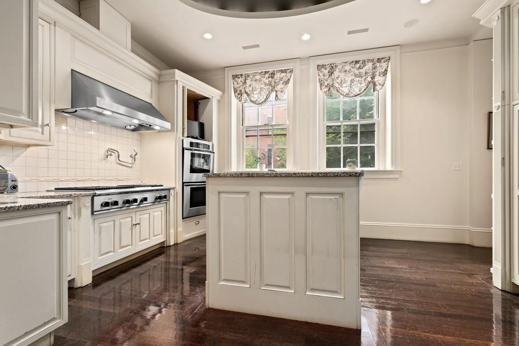 A large kitchen with a large island.