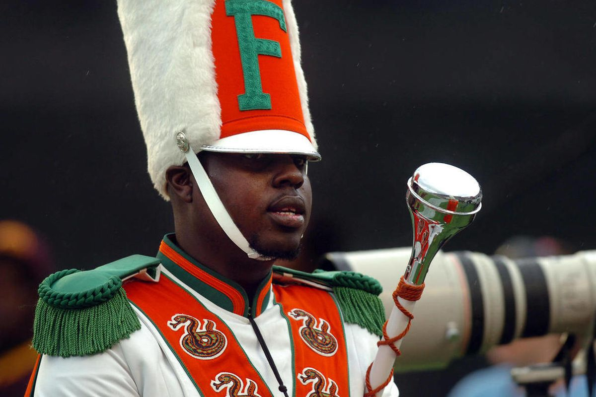 FILE - In this Saturday, Nov. 19, 2011 file photo, Robert Champion, a drum major in Florida A&M University's Marching 100 band, performs during halftime of a football game in Orlando, Fla. The parents of Robert Champion held a news conference in Atlanta,