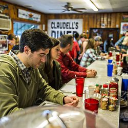 Drew Kann (left) sits at the counter bar as he looks at the menu with Anne Wise at Home Grown.