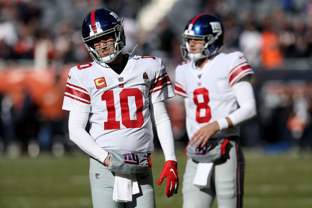 Eli Manning and Daniel Jones of the New York Giants warm up before the game against the Chicago Bears at Soldier Field on November 24, 2019 in Chicago, Illinois.
