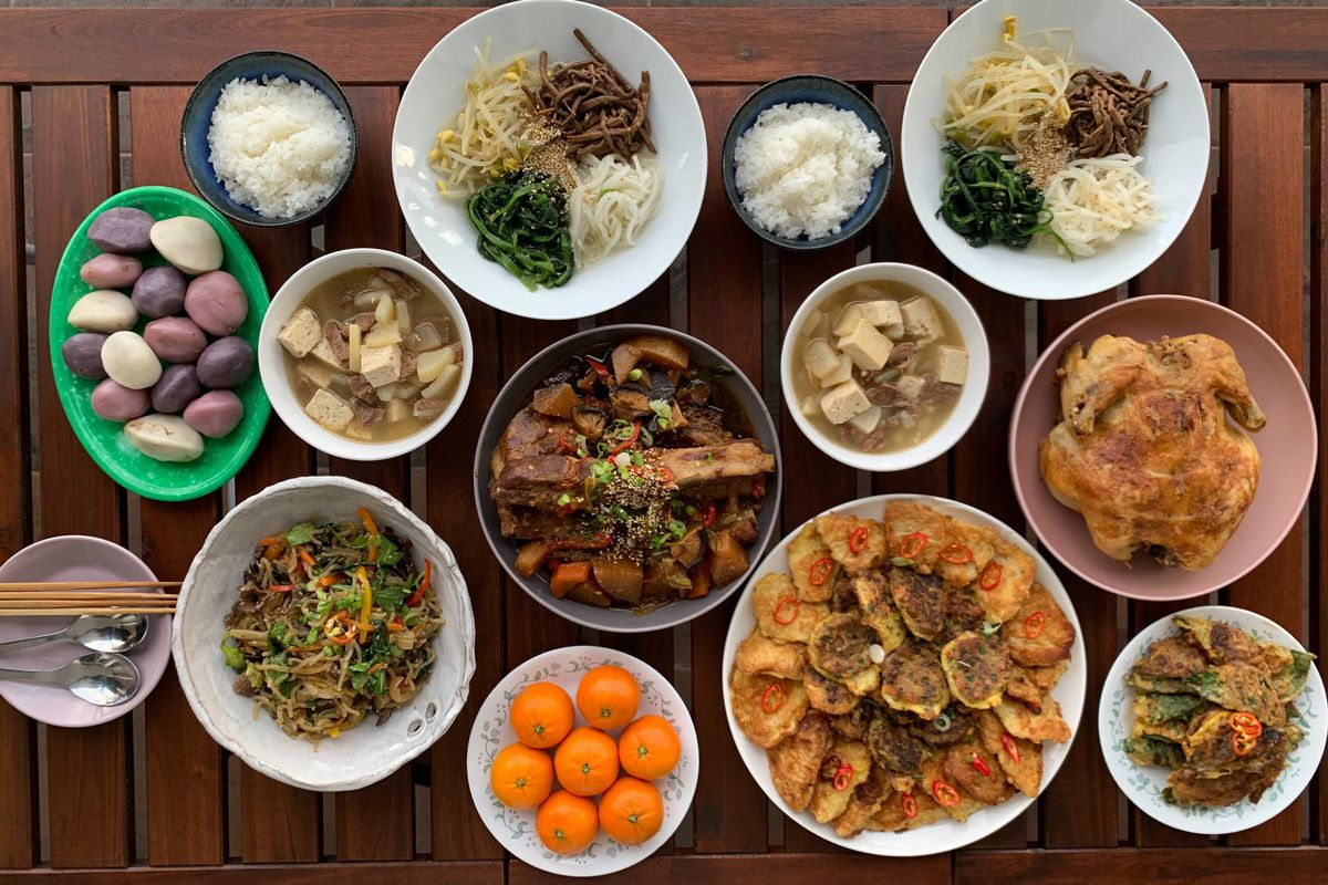 A variety of Korean dishes, as seen on a table from above.