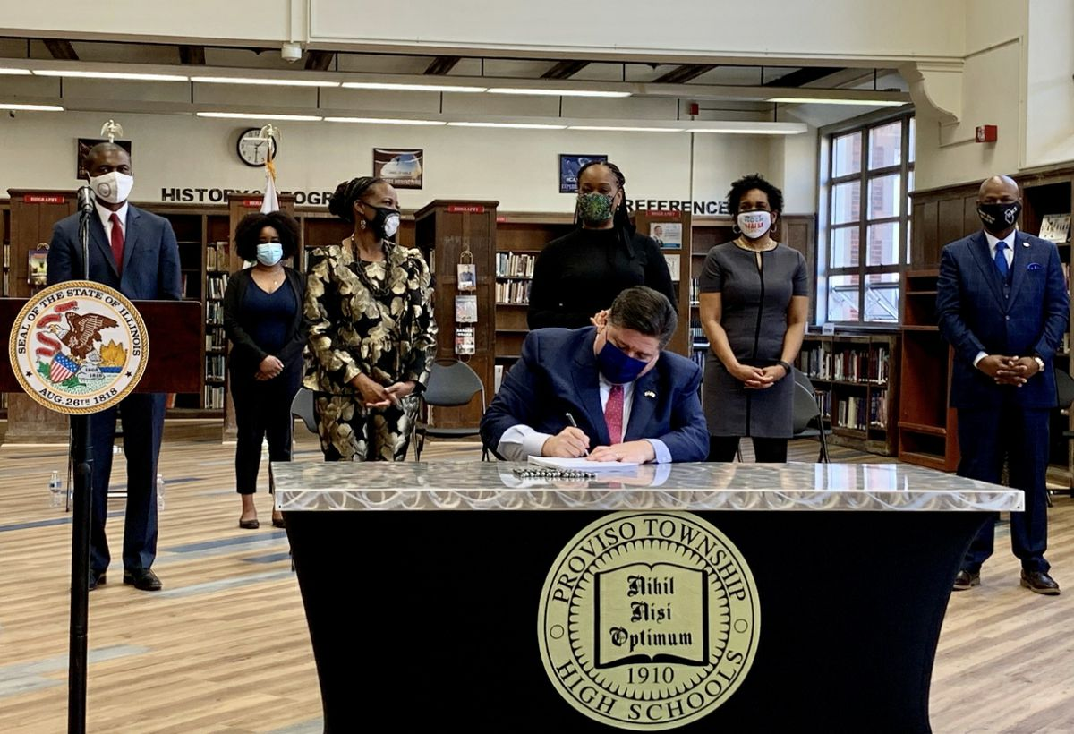 Gov. J.B. Pritzker signs the Education and Workforce Equity Act into law on Monday.