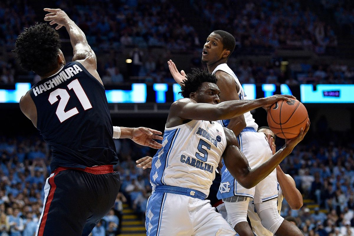 Nassir Little takes a rebound away from Rui Hachimura