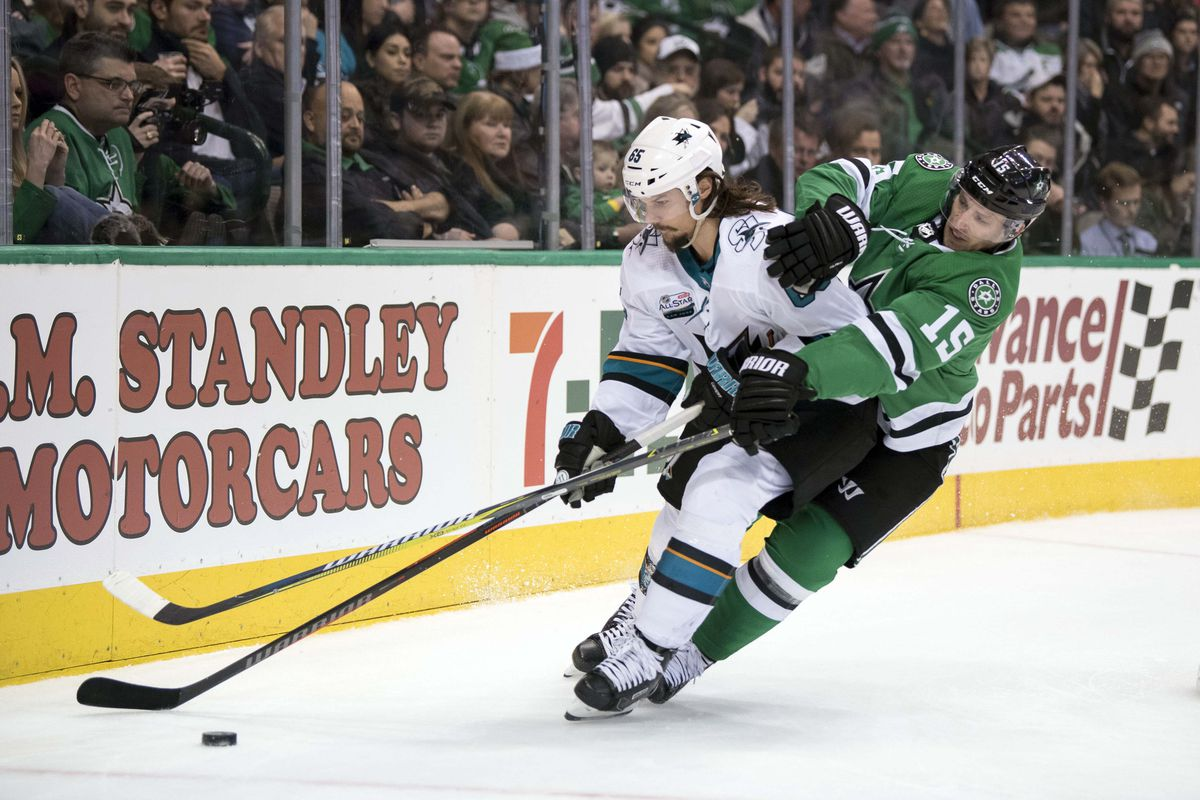 Dec 7, 2018; Dallas, TX, USA; Dallas Stars left wing Blake Comeau (15) and San Jose Sharks defenseman Erik Karlsson (65) fight for the puck during the second period at the American Airlines Center.