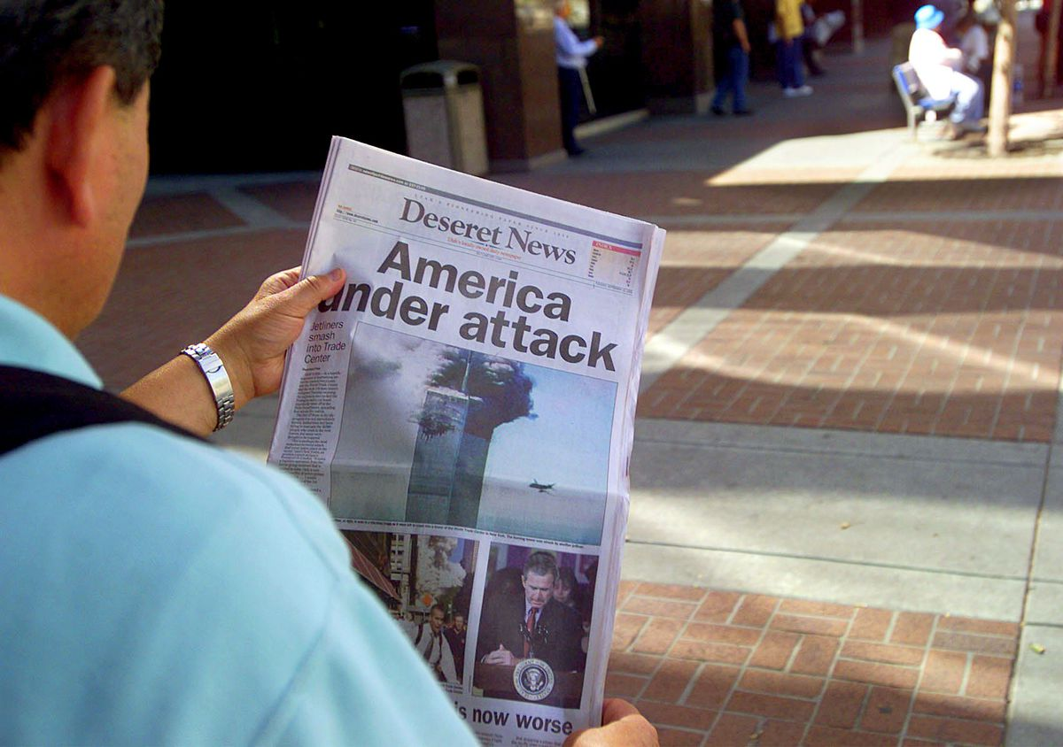 Rolando Alba of Salt Lake City reads the special edition of the Deseret News at 200 South and State Street Tuesday, Sept. 11, 2001