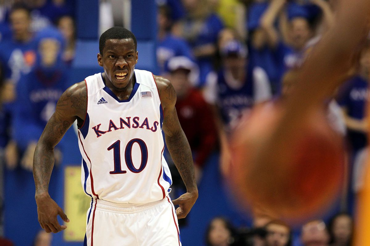 LAWRENCE, KS - DECEMBER 06:  Tyshawn Taylor #10 of the Kansas Jayhawks grimaces during the game against the Long Beach State 49ers on December 6, 2011 at Allen Fieldhouse in Lawrence, Kansas.  (Photo by Jamie Squire/Getty Images)