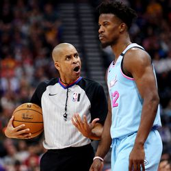 Referee Sean Corbin (33) talks with Miami Heat forward Jimmy Butler (22) on the sideline as the Utah Jazz and the Miami Heat play in an NBA basketball game at Vivint Smart Home Arena in Salt Lake City on Wednesday, Feb. 12, 2020. Utah won 116-101.