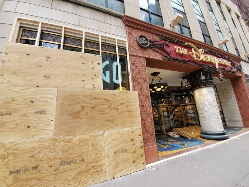 A handful of stores were boarded up on the Magnificent Mile Saturday before Gov. J.B. Pritzker's stay-at-home order takes effect.