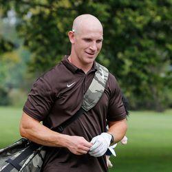Mount Carmel assistant golf coach Jordan Lynch walks the course during practice at Jackson Park Golf Course.