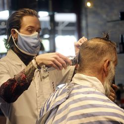 City Barbers manager Ace Parkin cuts Ed Cable's hair at City Barbers on Broadway between 200 East and 300 East in Salt Lake City on Thursday, June 18, 2020.