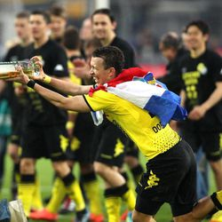 Dortmund's Ivan Perisic sprays with beer as he celebrates winning the 2nd consecutive Bundesliga title after winning 2-0 in the German first division Bundesliga soccer match between Borussia Dortmund and Borussia Moenchengladbach in Dortmund, Germany, Saturday, April 21, 2012.