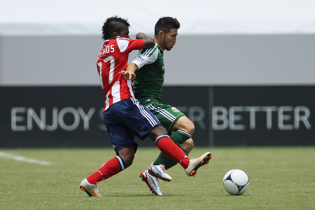 Miller Bolanos and the rest of Chivas USA are ready to rumble with Kosuke Kimura  and the Portland Timber one last time. (Photo by Victor Decolongon/Getty Images)