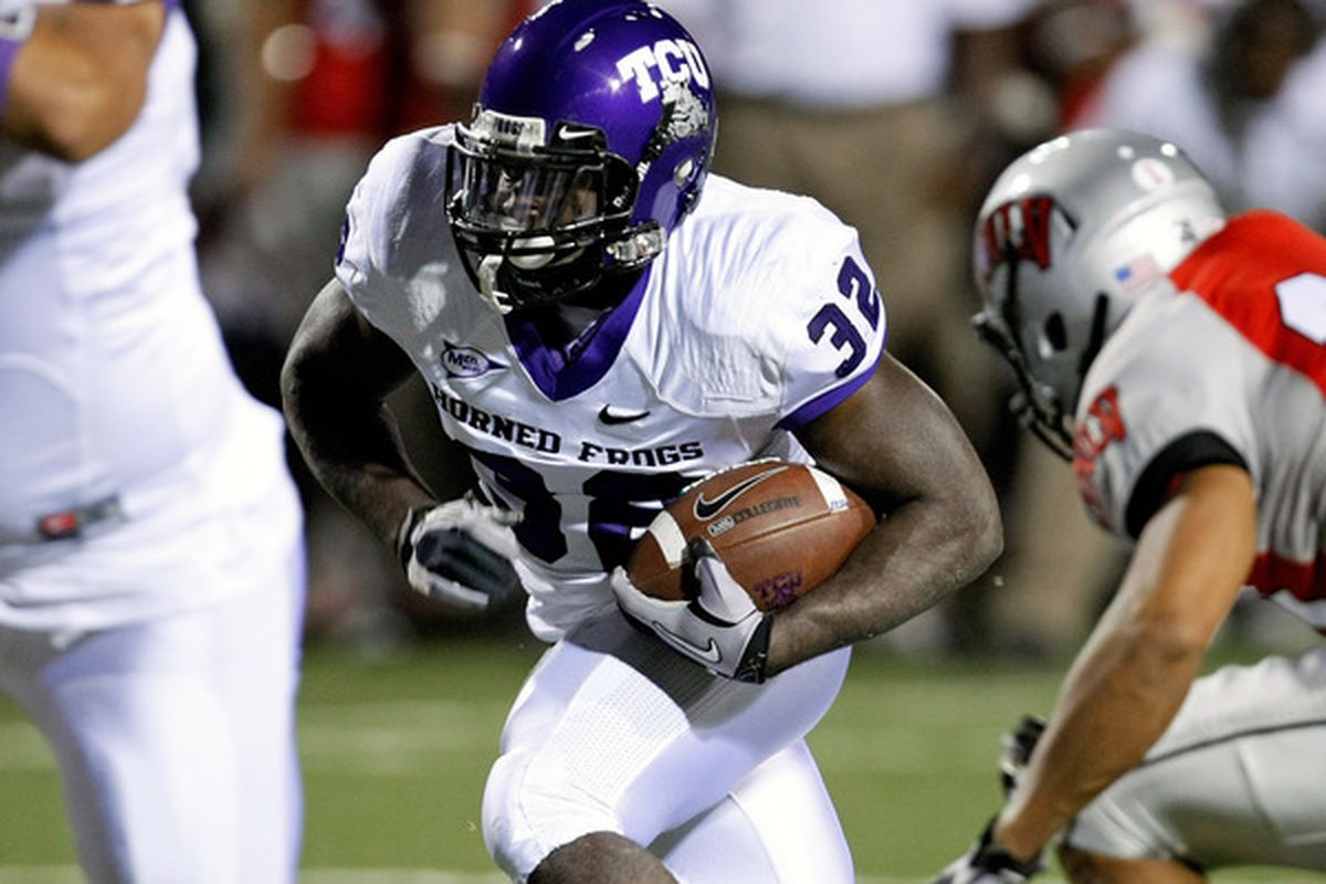 LAS VEGAS - OCTOBER 30:  Waymon James #32 of the Texas Christian University Horned Frogs runs for yardage against the UNLV Rebels at Sam Boyd Stadium October 30 2010 in Las Vegas Nevada. TCU won 48-6.  (Photo by Ethan Miller/Getty Images)