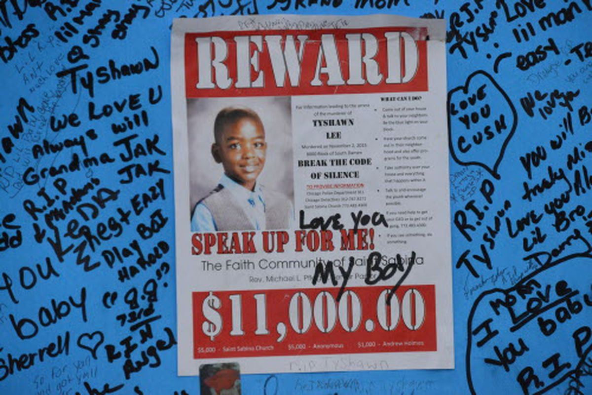 A poster at a memorial for Tyshawn Lee posted near where he was killed in 2015. Two men charged with the 9-year-old's murder are on trial.