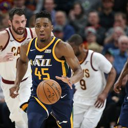 Utah Jazz guard Donovan Mitchell (45) moves down court during the game against the Cleveland Cavaliers at Vivint Arena in Salt Lake City on Saturday, Dec. 30, 2017.