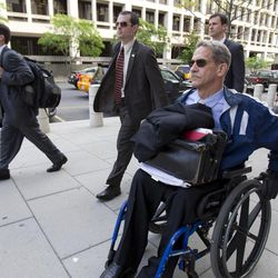Daniel Butler, the prosecutor for the perjury trial oof former Major League Baseball pitcher Roger Clemens, front, leaves Federal Court in Washington, Tuesday, April 17, 2012.