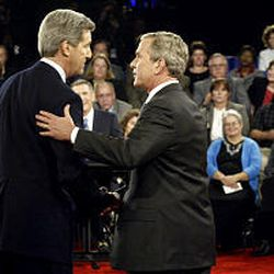 Democratic candidate Sen. John Kerry, left, and President Bush shake hands after their second presidential debate. They fielded 17 questions.