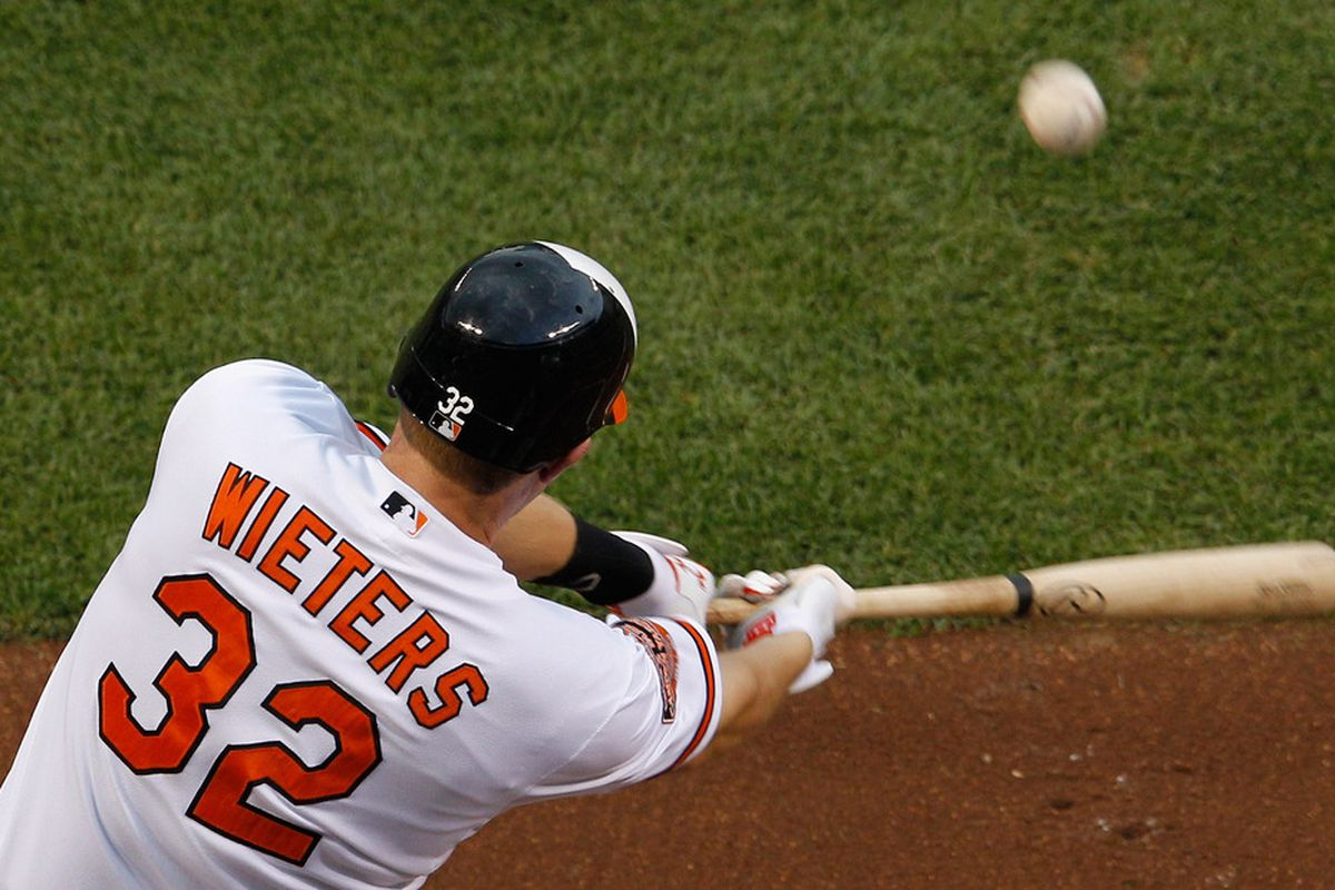 BALTIMORE, MD - JUNE 14: Matt Wieters #32 of the Baltimore Orioles hits an RBI single against the Pittsburgh Pirates during the first inning at Oriole Park at Camden Yards on June 14, 2012 in Baltimore, Maryland.  (Photo by Rob Carr/Getty Images)