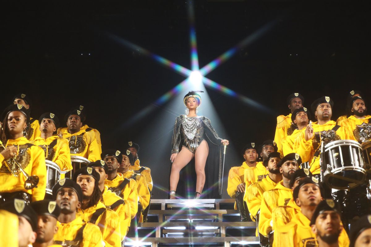 Beyonce stands above a marching band in Homecoming