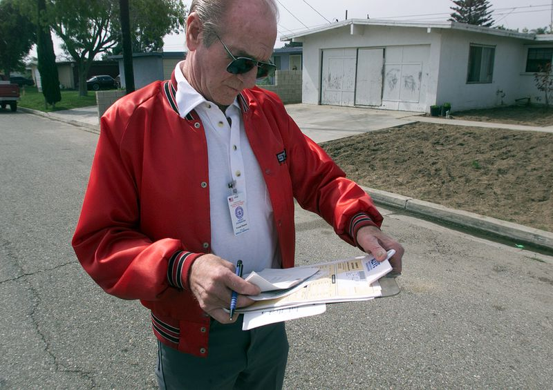A census worker going door-to-door to conduct follow-up interviews for the 2010 census.