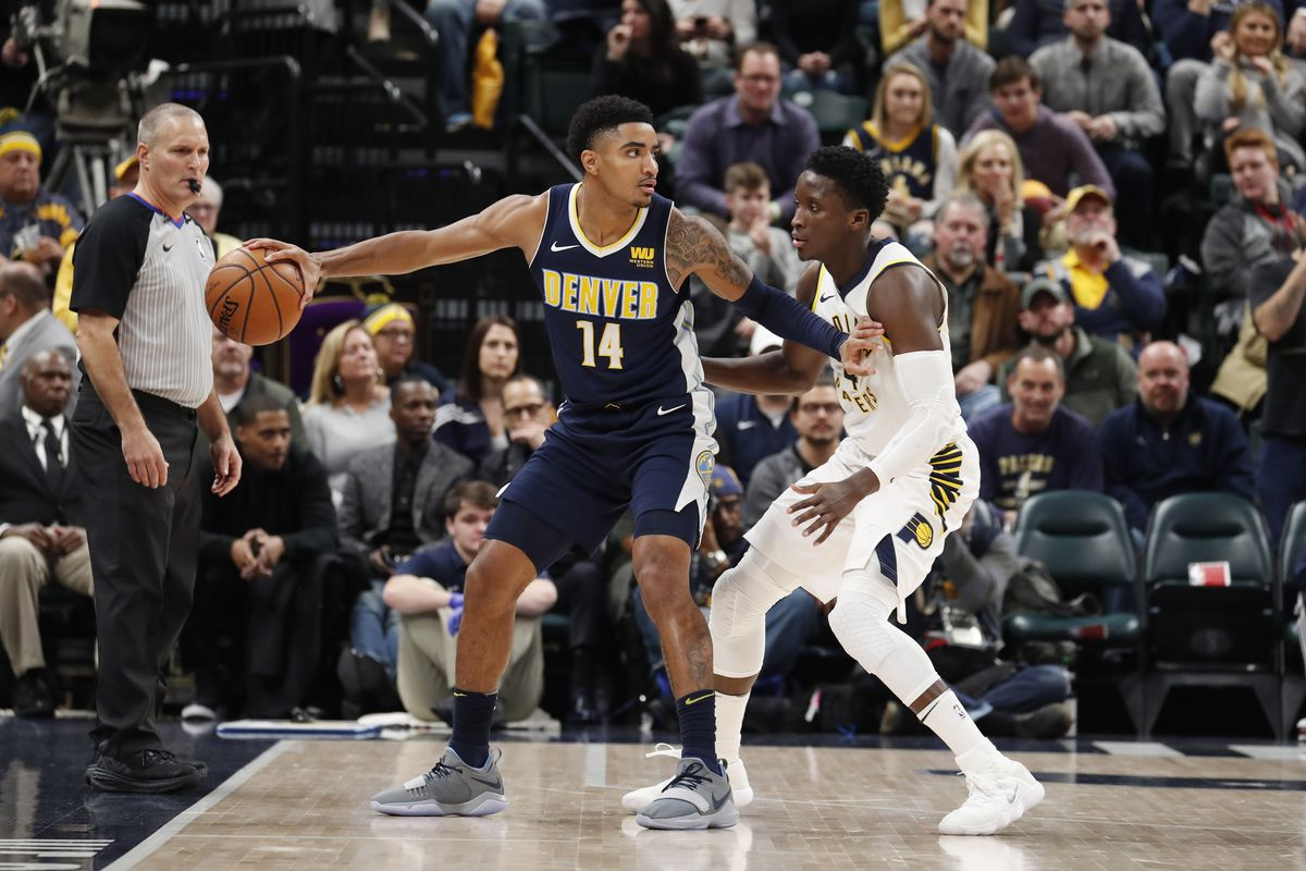 e19e8fa7933 Denver Nuggets guard Gary Harris (14) is guarded by Indiana Pacers guard  Victor Oladipo (4) during overtime at Bankers Life Fieldhouse.