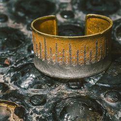 "Atelier Zobel cuff, <a href=""https://brokenenglishjewelry.com/shop/bracelets/champagne-diamond-cuff/"">$25,167</a>"