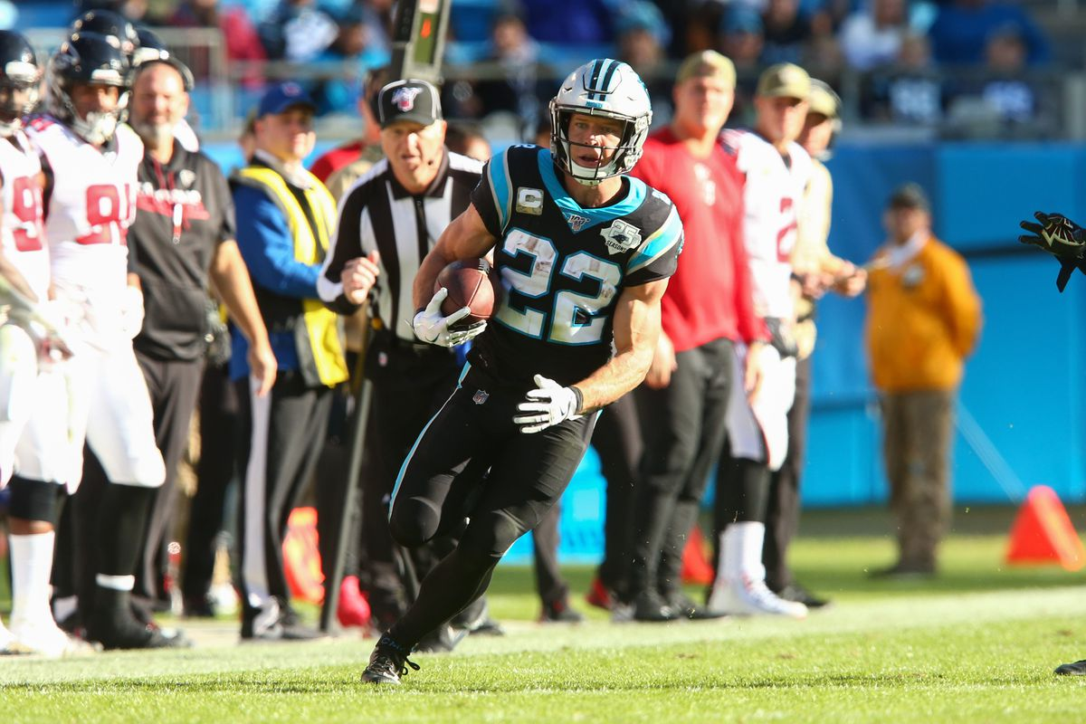 Carolina Panthers running back Christian McCaffrey carries the ball during the third quarter against the Atlanta Falcons at Bank of America Stadium.