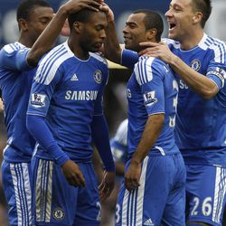 Chelsea's Daniel Sturridge, second left, celebrates with Ashley Cole, second right, and John Terry, right, after scoring against Queens Park Rangers during their English Premier League soccer match at Stamford Bridge Stadium in London, Sunday, April 29, 2012.