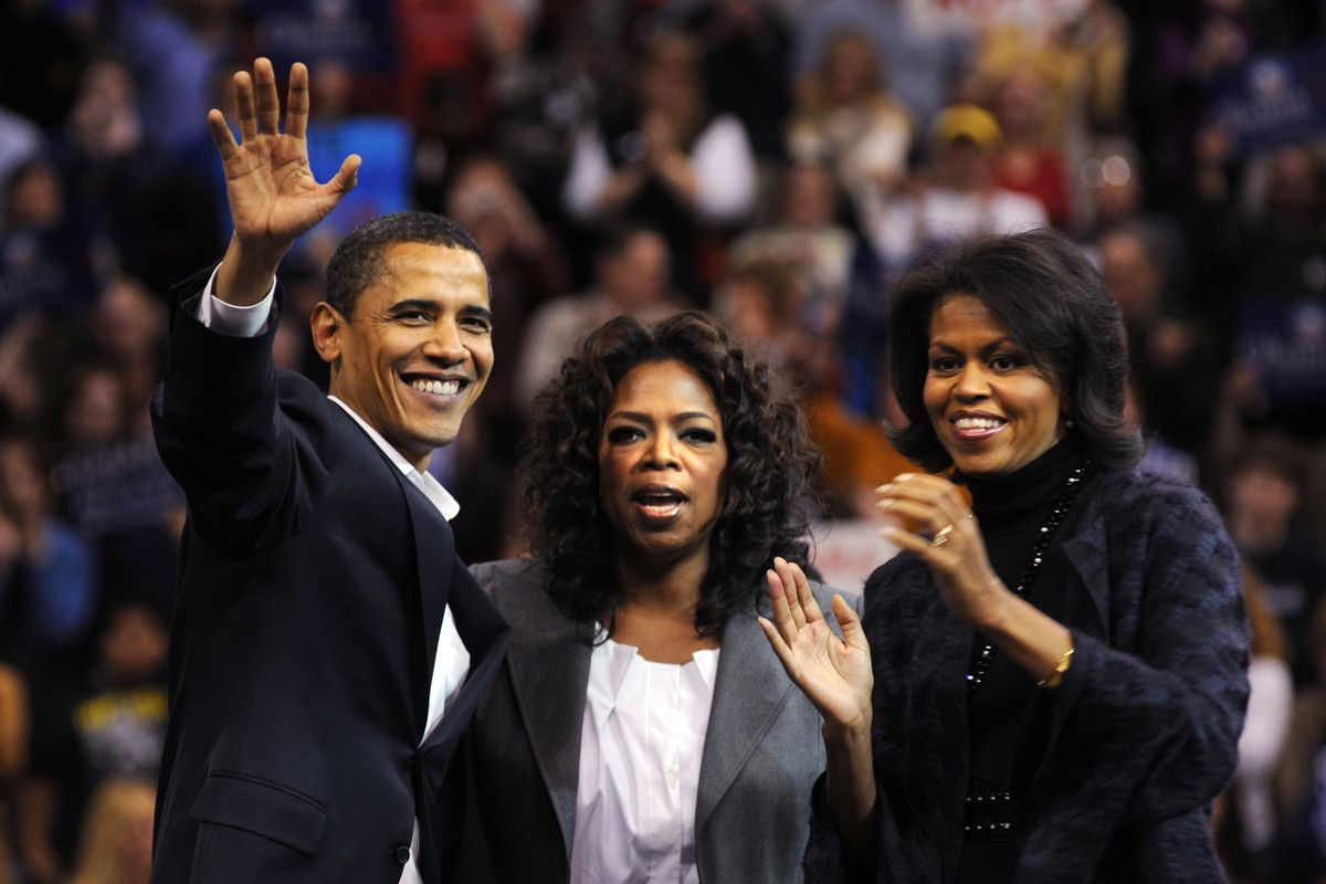 Oprah Winfrey appears with then-Sen. Barack Obama and his wife, Michelle Obama, on the campaign trail during the 2008 Democratic primary in December 2007.