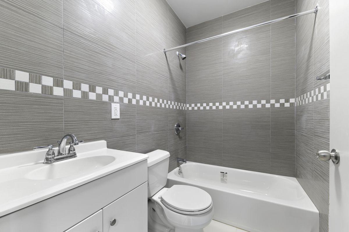 A bathroom with grey walls.