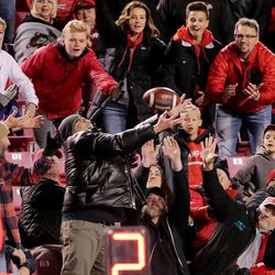 Utah Utes fans try to catch a ball that was thrown into the stands by UCLA Bruins quarterback Dorian Thompson-Robinson (1) as Utah and UCLA play a college football game in Salt Lake City at Rice-Eccles Stadium on Saturday, Nov. 16, 2019. Utah won 49-3.