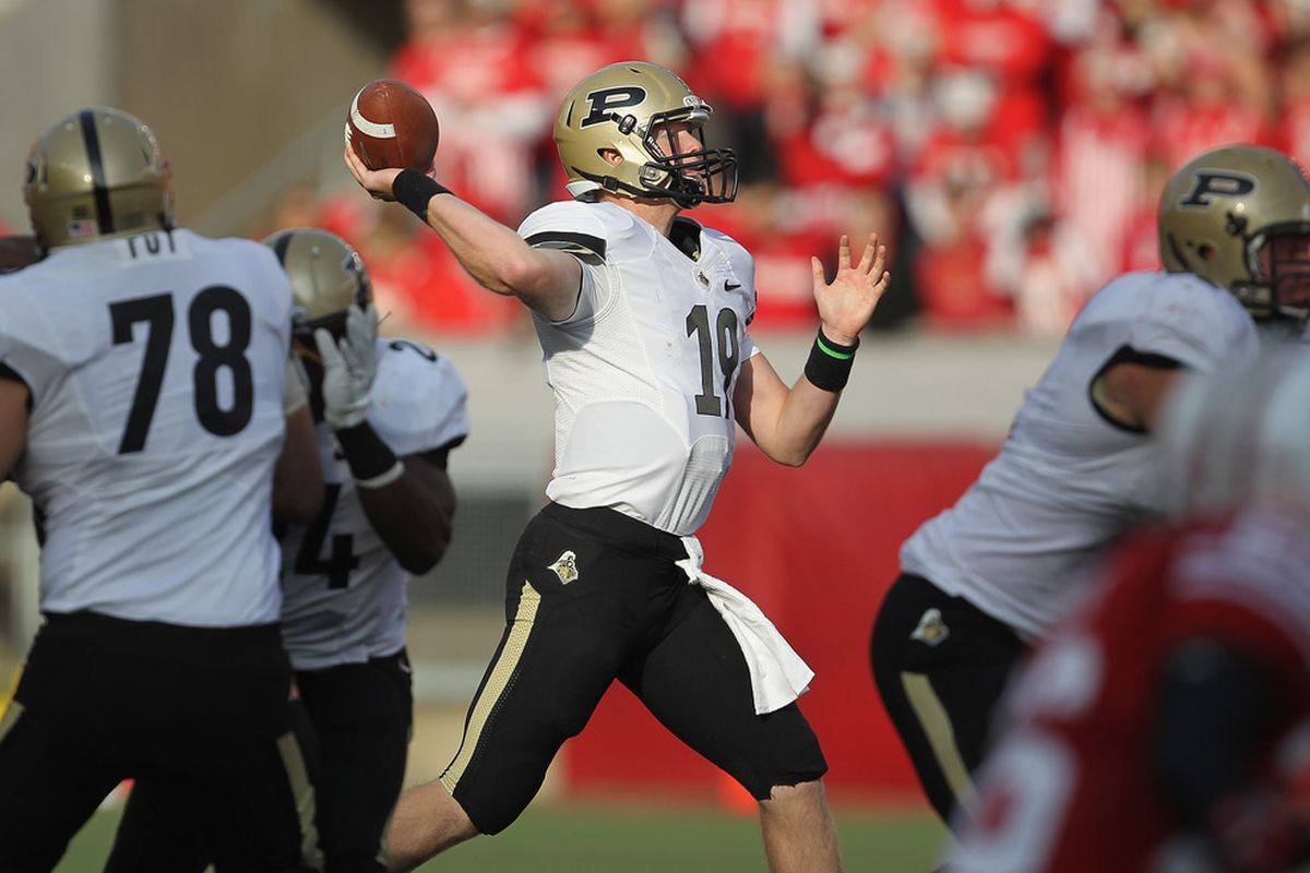 MADISON, WI - NOVEMBER 05: Starting quarterback Caleb TerBush #19 of the Purdue Boilermakers attempts a pass against the Wisconsin Badgers at Camp Randall Stadium on November 5, 2011 in Madison Wisconsin.  (Photo by Jonathan Daniel/Getty Images)