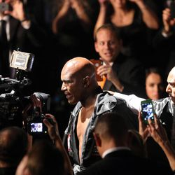 Five-time heavyweight champion Evander Holyfield walks to the ring to fight former Massachusetts Gov. Mitt Romney during Charity Vision Fight Night at The Rail Event Center in Salt Lake City on Friday, May 15, 2015.