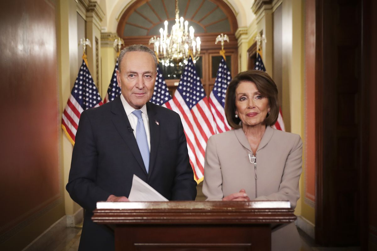 Speaker of the House Nancy Pelosi (D-CA) and Senate Minority Leader Charles Schumer (D-NY) pose for photographs after delivering a televised response to President Trump's national address about border security on January 08, 2019.