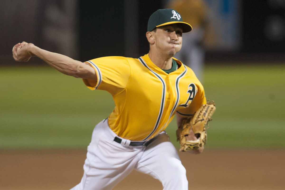 Pat Venditte, pitching right-handed.