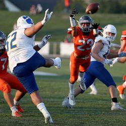 Skyridge's Dalton Young dives to block Orem's Moses Kivalu's punt during a high school football game at Skyridge High School in Lehi on Friday, Sept. 3, 2021. Skyridge won 36-0.
