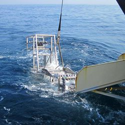 This June 2012 photo provided by the National Oceanic and Atmospheric Administration shows Seahorse, the latest and most sophisticated version of the marine habitat mapping camera system, HabCam, being recovered after a sea scallop survey off the Delaware coast. The apparatus was created to get better information about scallops, which bring fishermen a half-billion dollars in revenues annually.