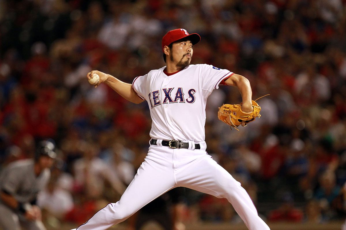 ARLINGTON, TX - AUGUST 10:  Koji Uehara #19 of the Texas Rangers throws against the Seattle Mariners at Rangers Ballpark in Arlington on August 10, 2011 in Arlington, Texas.  (Photo by Ronald Martinez/Getty Images)