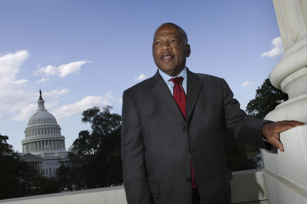 In this Oct. 10, 2007, file photo, with the Capitol Dome in the background, U.S. Rep. John Lewis, D-Ga., poses on Capitol Hill in Washington.