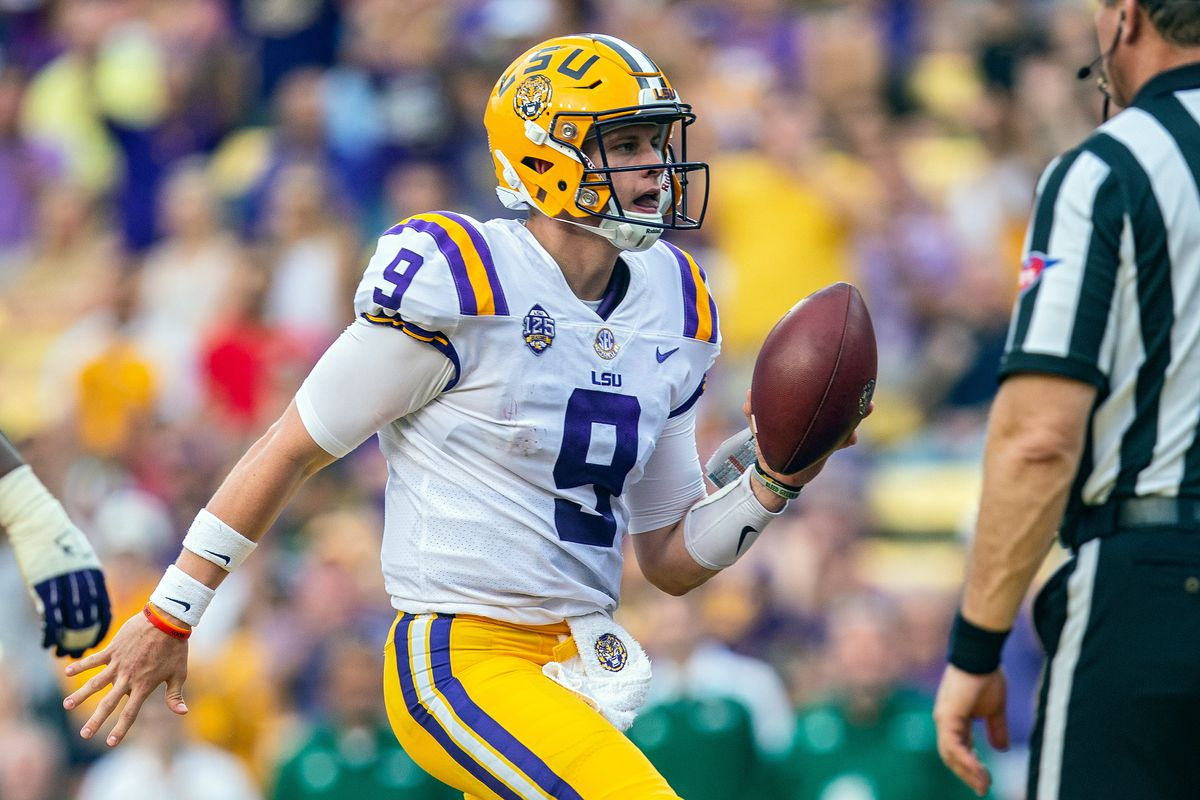 LSU Tigers quarterback Joe Burrow rushes the ball for a touchdown during a game between the LSU Tigers and Southeastern Louisiana Lions at Tiger Stadium in Baton Rouge, Louisiana on September 8, 2018.