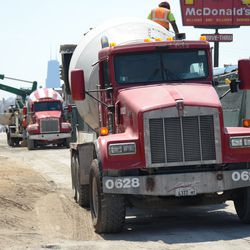 Thu 11:23 a.m. Concrete trucks parked along Clark Street -