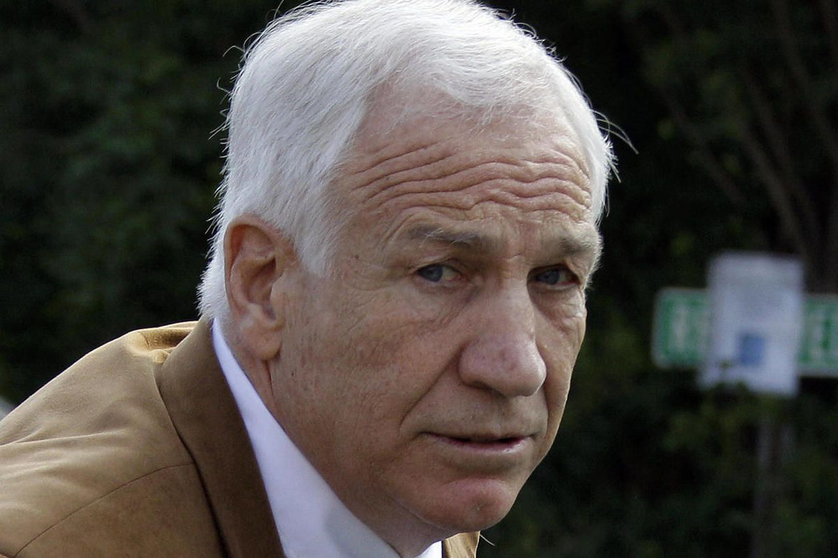 FILE - This June 22, 2012 file photo shows former Penn State assistant football coach Jerry Sandusky arriving at the Centre County Courthouse in Bellefonte, Pa. A key witness _ Victim 1 _ against Sandusky has a book deal and will soon reveal his identity.