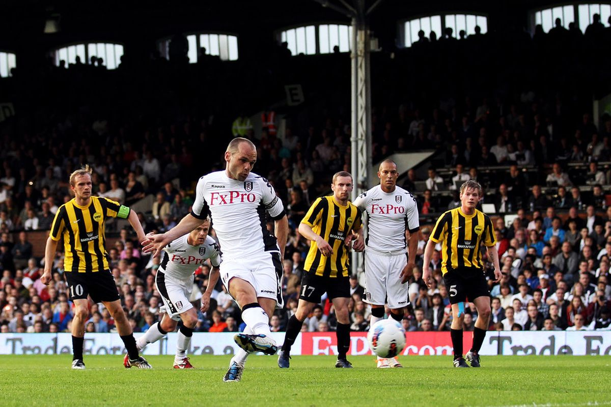 LONDON, ENGLAND - JUNE 30:  Danny Murphy of Fulham shoots to score a penalty during the UEFA Europa League qualifying match between Fulham and NSI Runavik at Craven Cottage on June 30, 2011 in London, England.  (Photo by Warren Little/Getty Images)